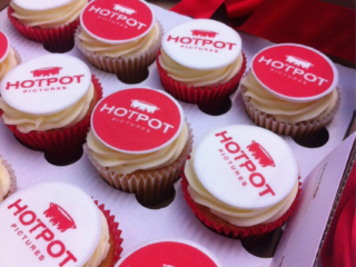 Boxed corporate hotpot iced cupcakes