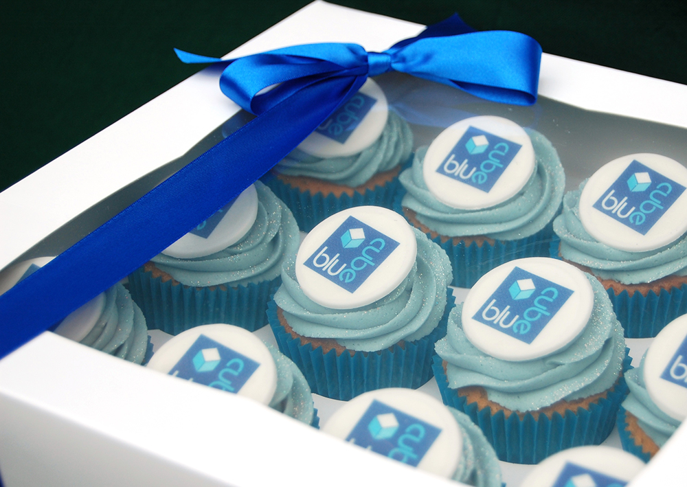 Corporate Blue Cube iced and boxed cupcakes